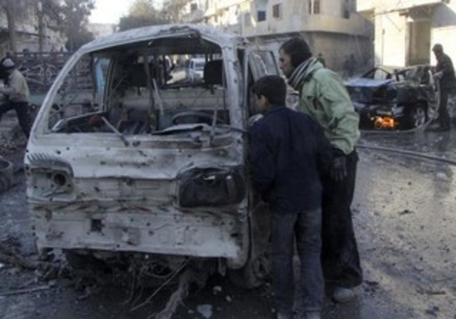 Syrians inspect damaged vehicle after Aleppo airstrike