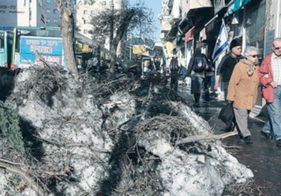 Snow is still piled up on King George St. in Jerusalem more than a week after the storm.