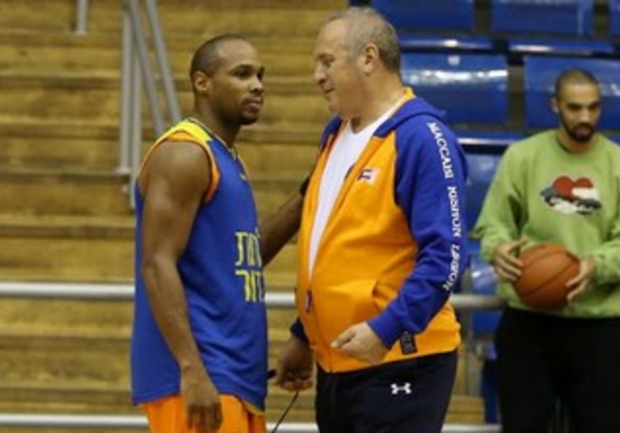 Maccabi Rishon Lezion's coach Tzvika Sherf and guard Brian Hopkins.