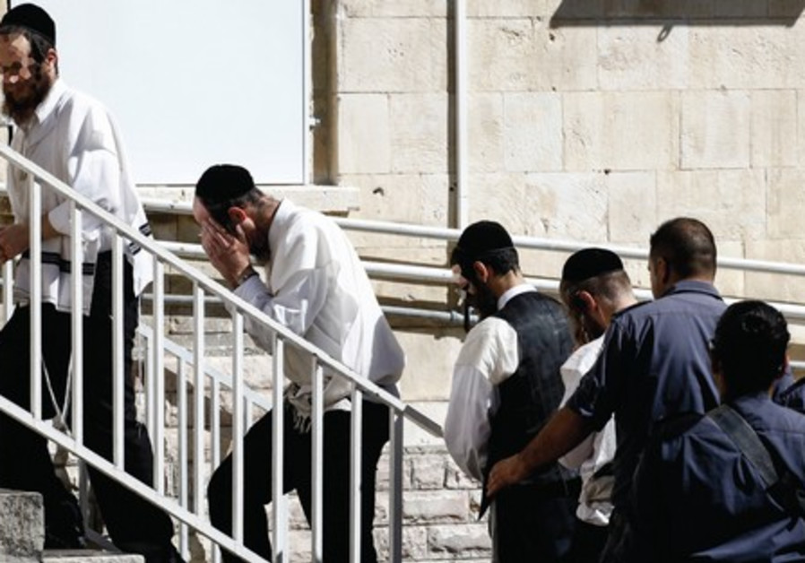 Ultra-Orthodox are brought into Magistrate's Court in Jerusalem, Oct 28, suspected of voter fraud.
