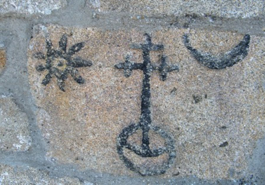 Discovered on the wall of a church a cross is similar to those found in former Jewish quarters.