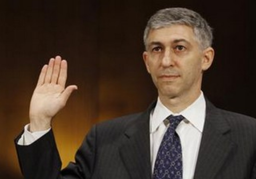Stuart Levey is sworn in before testifying in Washington July 17, 2012.
