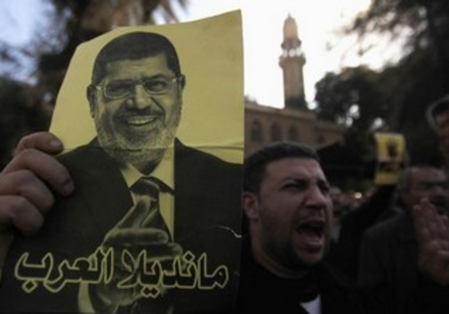 Supporters of the Muslim Brotherhood protest in Egypt, December 27, 2013.