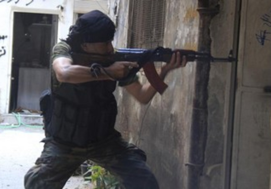 A Free Syrian Army fighter in the Yarmouk district