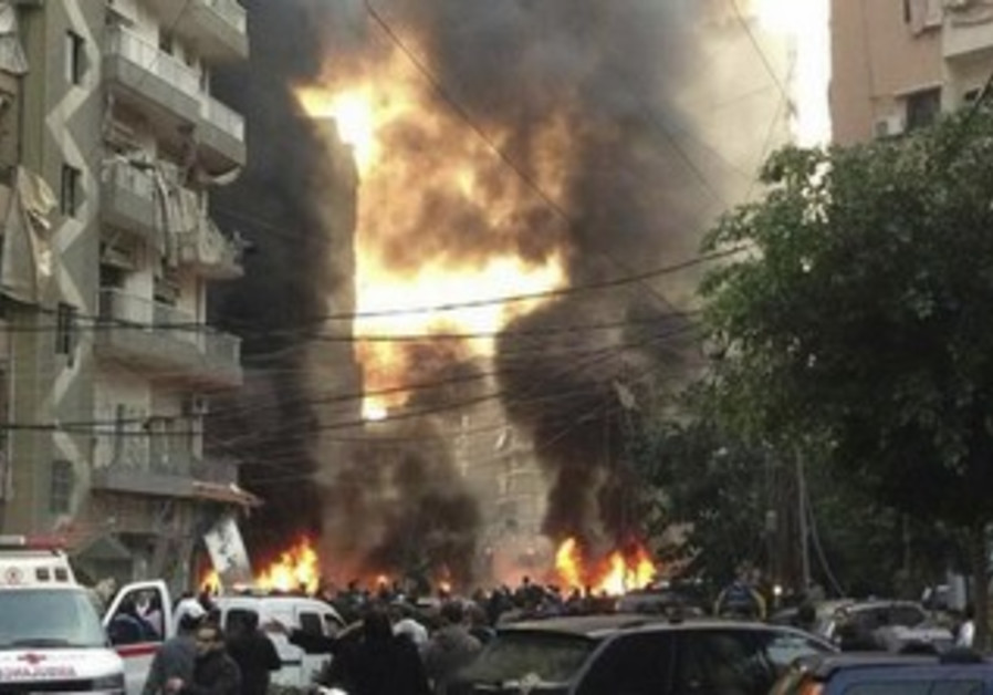 Fire and smoke is seen at the site of a blast in Beirut's southern suburbs January 2, 2014.
