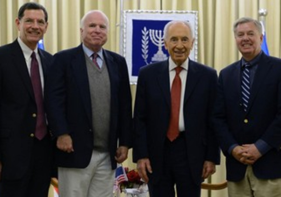 President Shimon Peres with US senators.