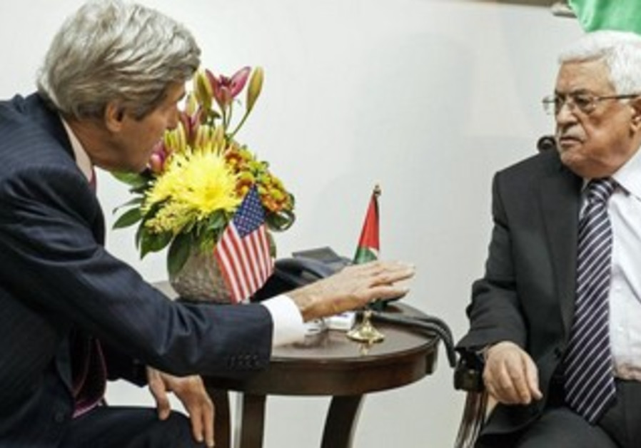 US Secretary of State John Kerry and chief PLO negotiator Saeb Erekat speaking to reporters in Ramal