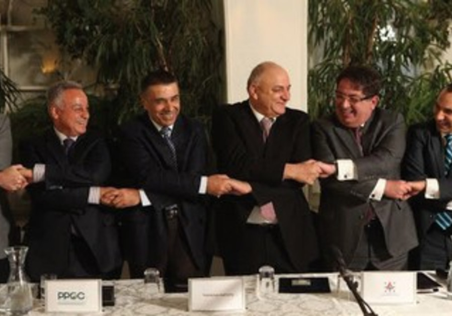 Officials from Delek and the Palestinian Authority
