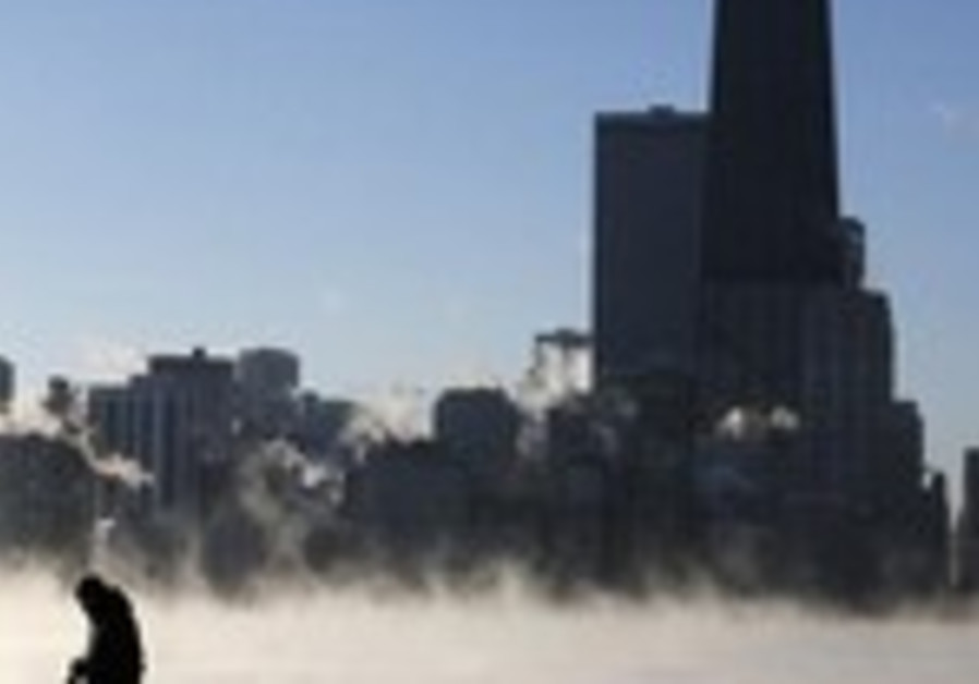 Steam rises from Lake Michigan as Chicagoans brave Arctic weather