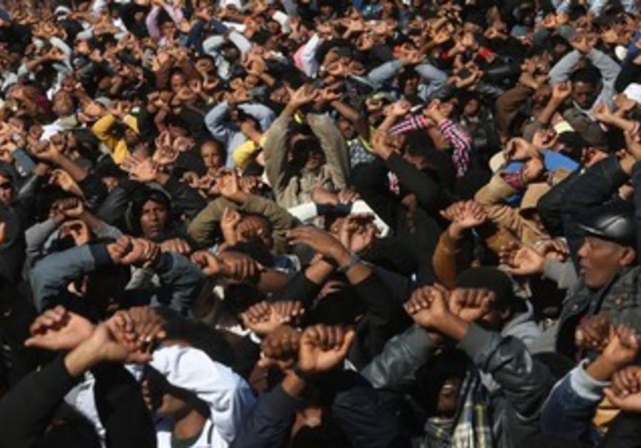 migrants shackles gesture