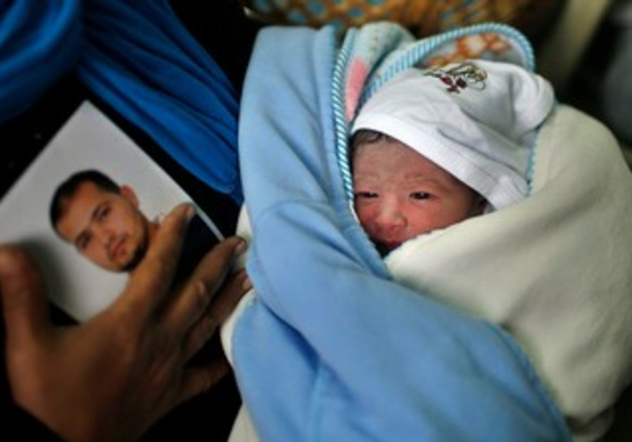 Palestinian baby Al-Hassan, who was conceived with smuggled sperm of Palestinian prisoner.