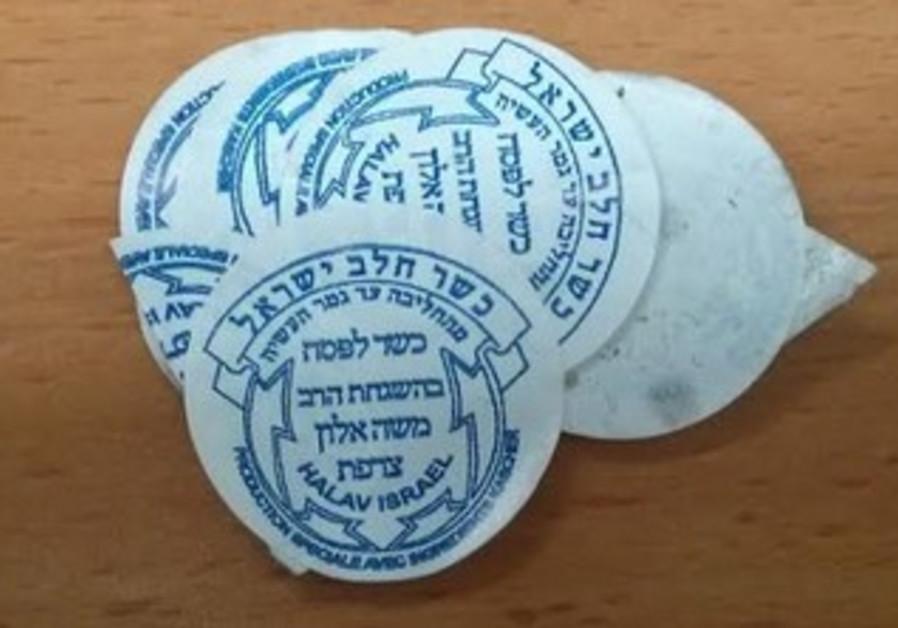 Stickers with kashrut stamp of Rabbi Moshe Alloun.