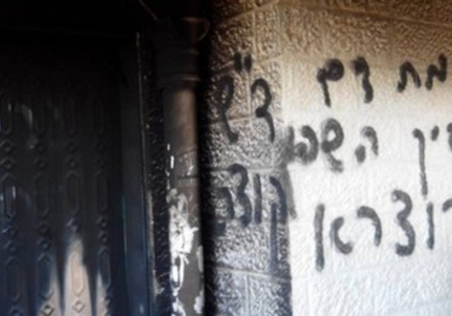 The damage from an attempted arson at a mosque in West Bank
