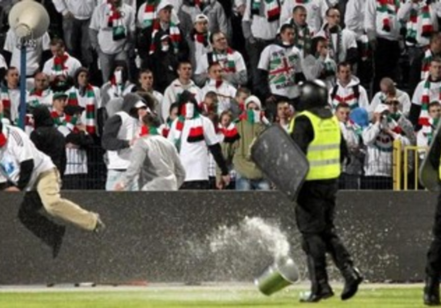Polish soccer fans clash with police