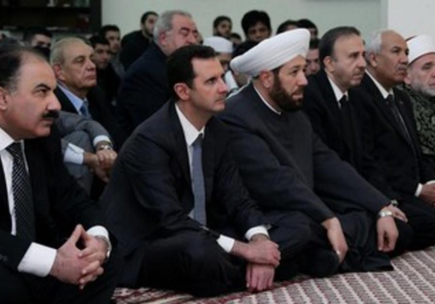 Syrian President Bashar Assad attends prayers marking the birth of the Prophet Muhammed