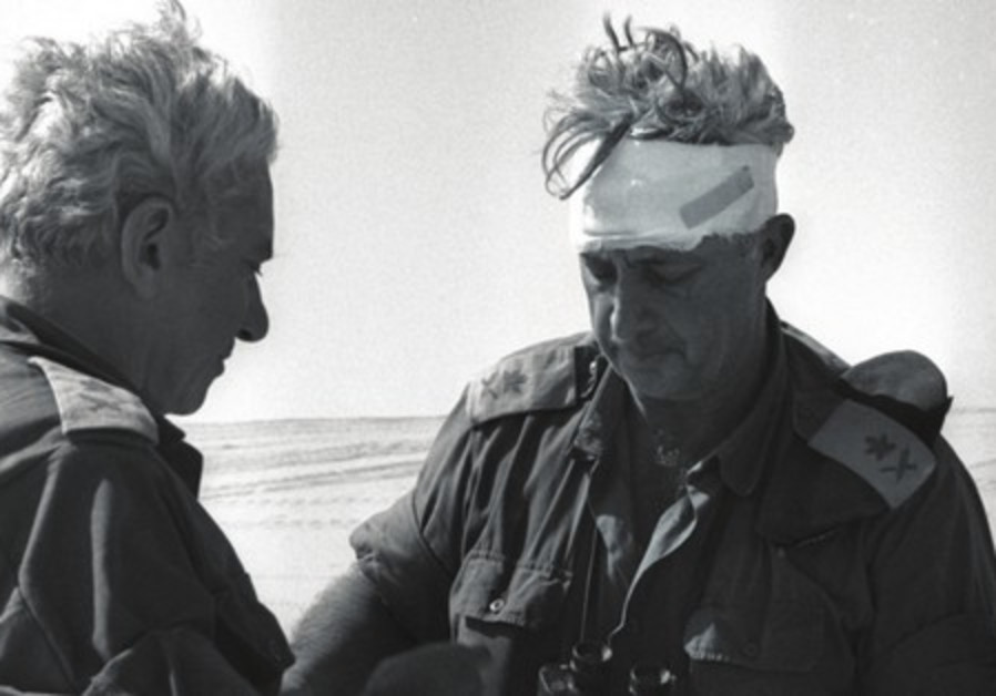 Former Chief of Staff Haim Bar-Lev consults with Maj. Gen. Ariel Sharon during the Yom Kippur War