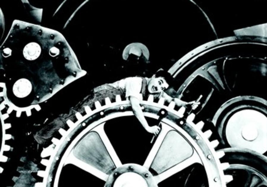 Charlie Chaplin dans le film les Temps modernes