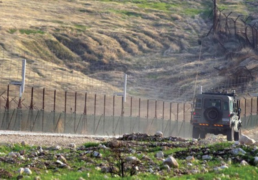 An Israel army vehicle patrols the Jordanian border in the Jordan Rift Valley, January 1