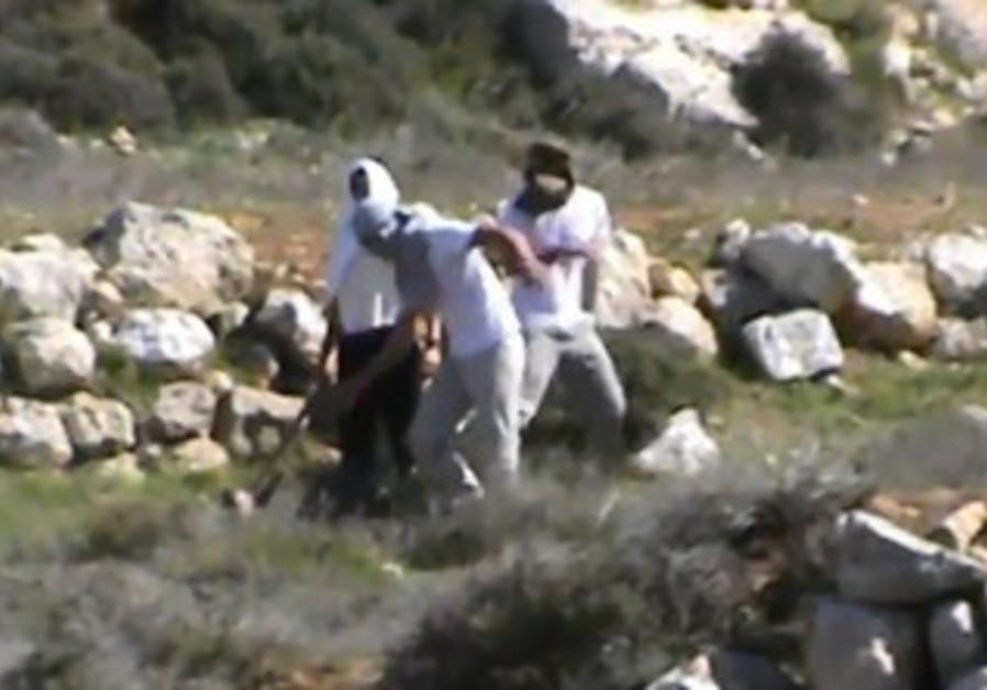 Settlers attack activist.