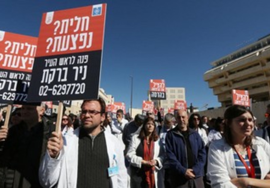Doctors and medical personnel demonstrate outside the prime minister's office.
