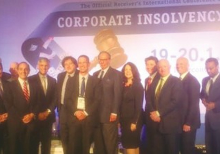 DAVID HAHN (fifth from left) and renowned US attorney Harvey Miller (sixth from left)