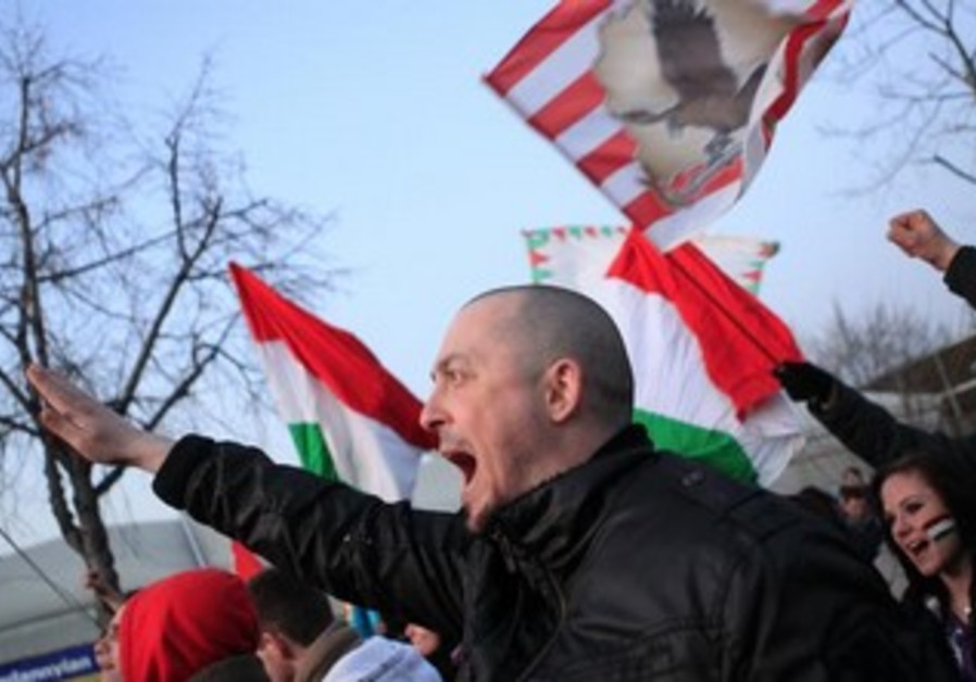 Hungarian far-rightists shout slogans outside a soccer match.