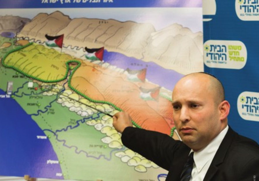 Bayit Yehudi party leader Naftali Bennett points to a map of Palestinian state looming over Israel