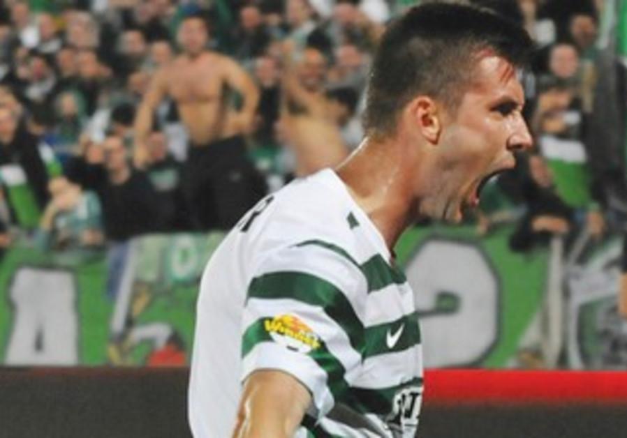 Maccabi Haifa striker Tamas Priskin celebrates at Kiryat Eliezer Stadium.