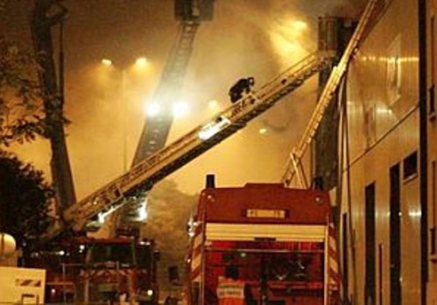 paris riots firefighters fighting blaze 298 ap