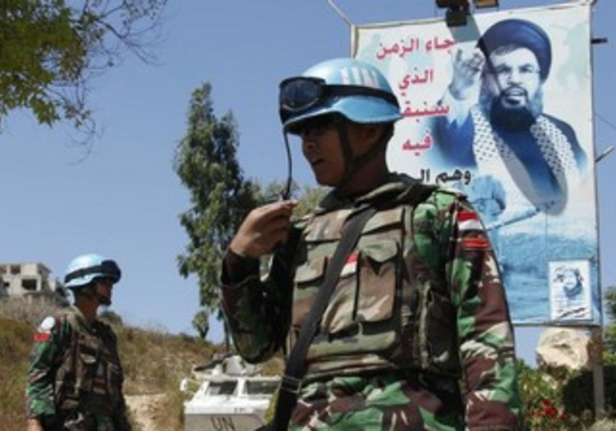 UNIFIL in front of Nasrallah poster