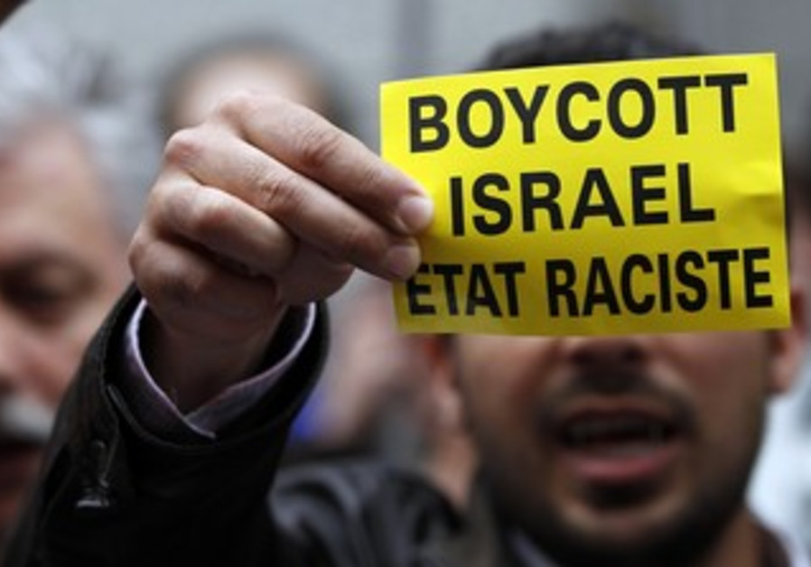 Man holds boycott Israel sign