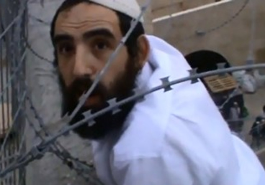 Hebron man caught in barbed wire trying to remove Palestinian flag