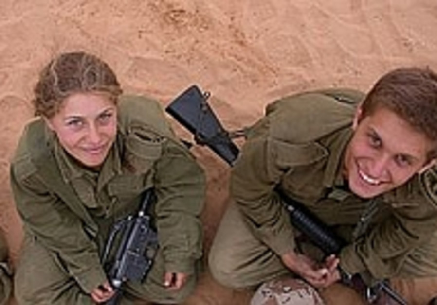 smiling soldiers look up while sitting in sand 298
