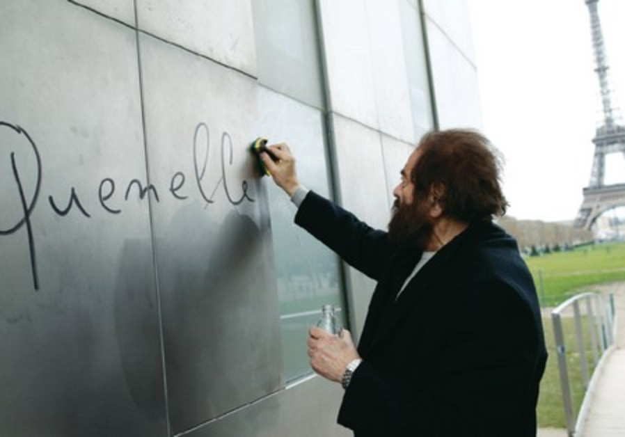 The word 'quenelle,' an anti-Semitic reference, is removed from 'The Wall For Peace' in Paris.