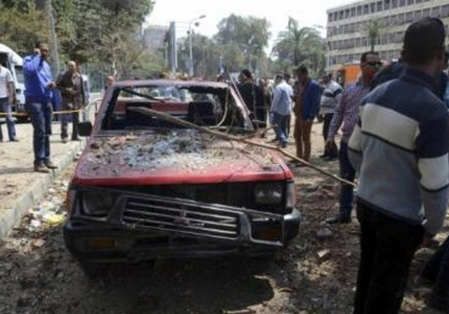 A car damaged by explosions near Cairo University, April 2