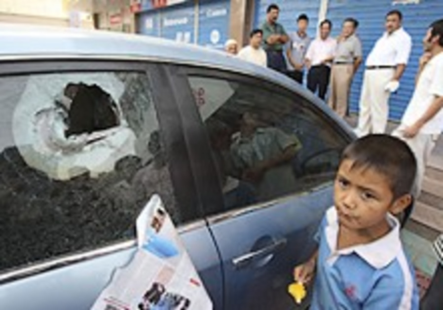 New violence in China's west kills 11