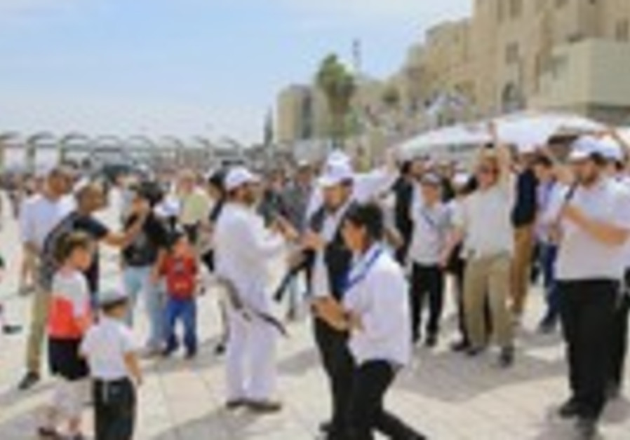 Orphans celebrate bar mitzva at Kotel