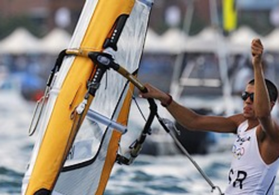 Tzuberi drops to third in Olympic windsurfing competition