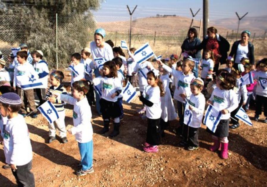 Children at dedication ceremony of a new neighborhood in the settlement of Gitit in Jordan Valley