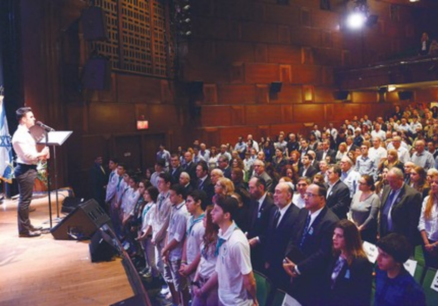 CROWD STANDS during the Remembrance Day memorial service in New York