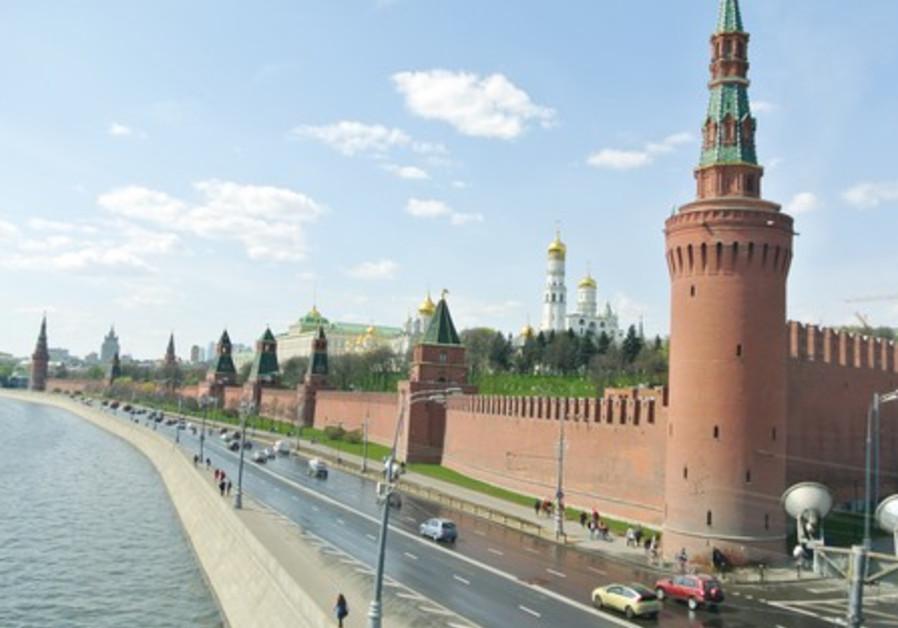 THE KREMLIN'S medieval turrets line the Moskva River