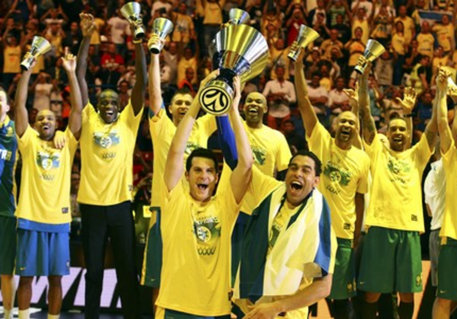 Maccabi Tel Aviv s Guy Pnini (L) and David Blu hold the trophy as they  celebrate with teammates after winning their Euroleague Final Four final  basketball ... cba9a600b