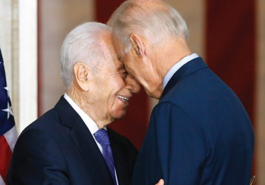 PRESIDENT SHIMON PERES embraces US Vice President Joe Biden