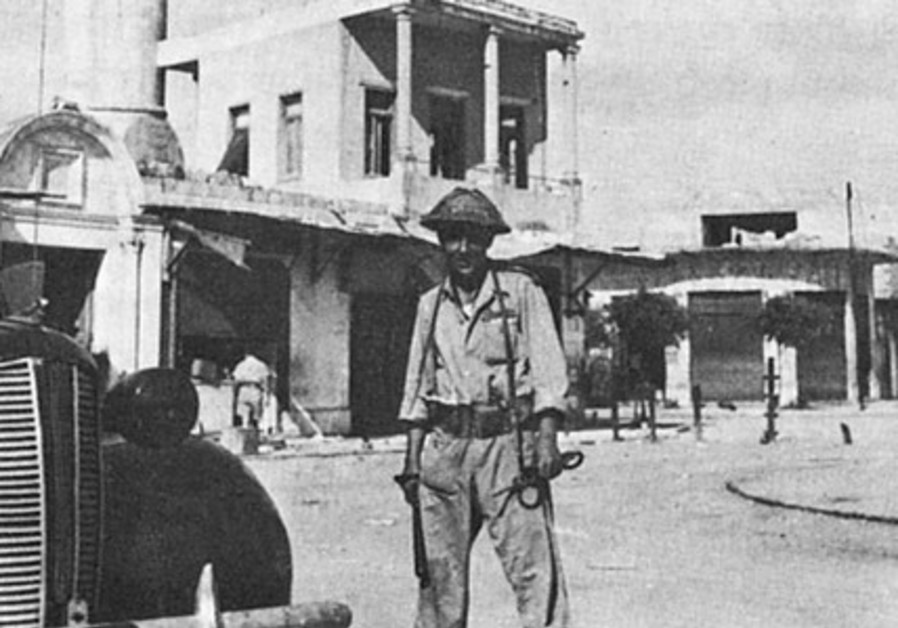 An Israeli soldier in central Lydda in July 1948