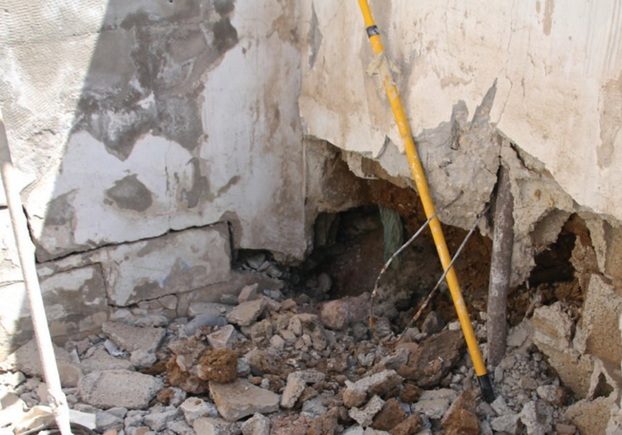 STRUCTURAL DAMAGE to a wall can be seen after a Hamas rocket struck it yesterday in Netivot