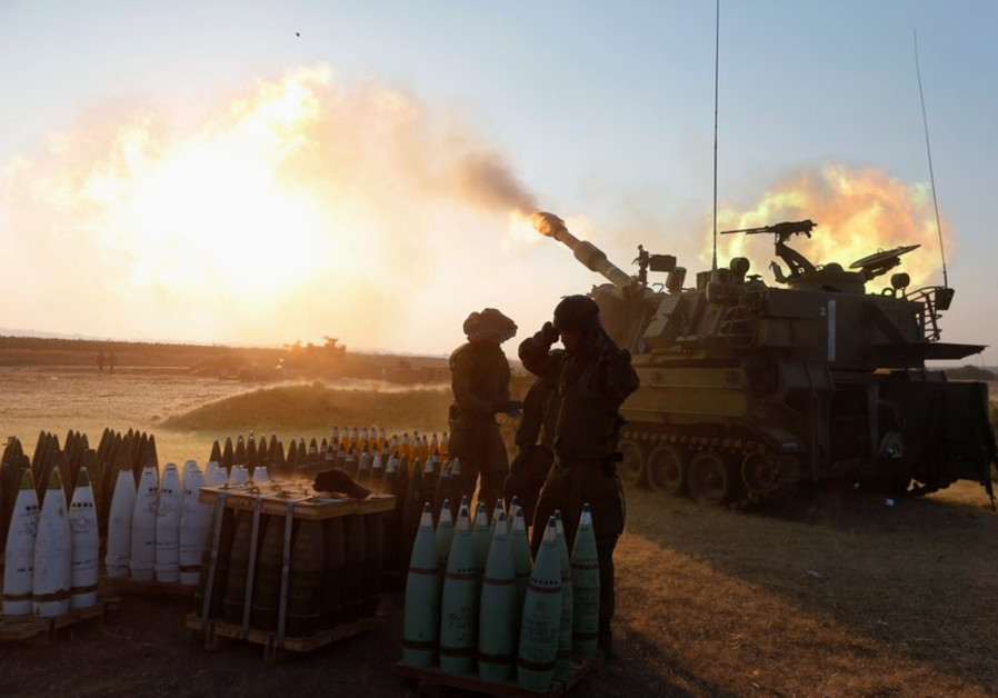 An Israeli mobile artillery unit fires towards the Gaza Strip July 21