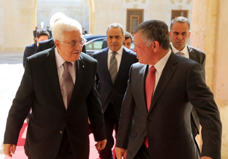 Jordan's King Abdullah (R) welcomes Palestinian President Mahmoud Abbas at the Royal Palace in Amman