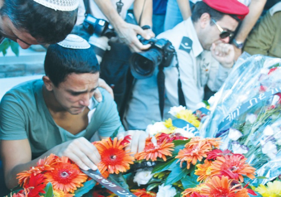 YOSIEL CHALON mourns for his father, Chief Warrant Officer Rami Chalon, during his funeral in Hadera