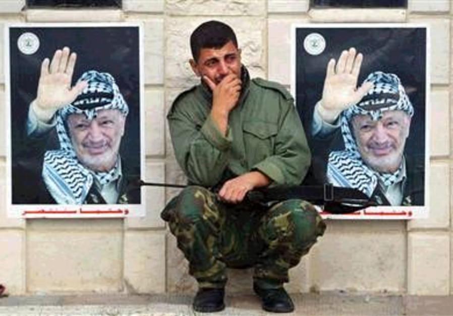 policeman mourns arafat 298