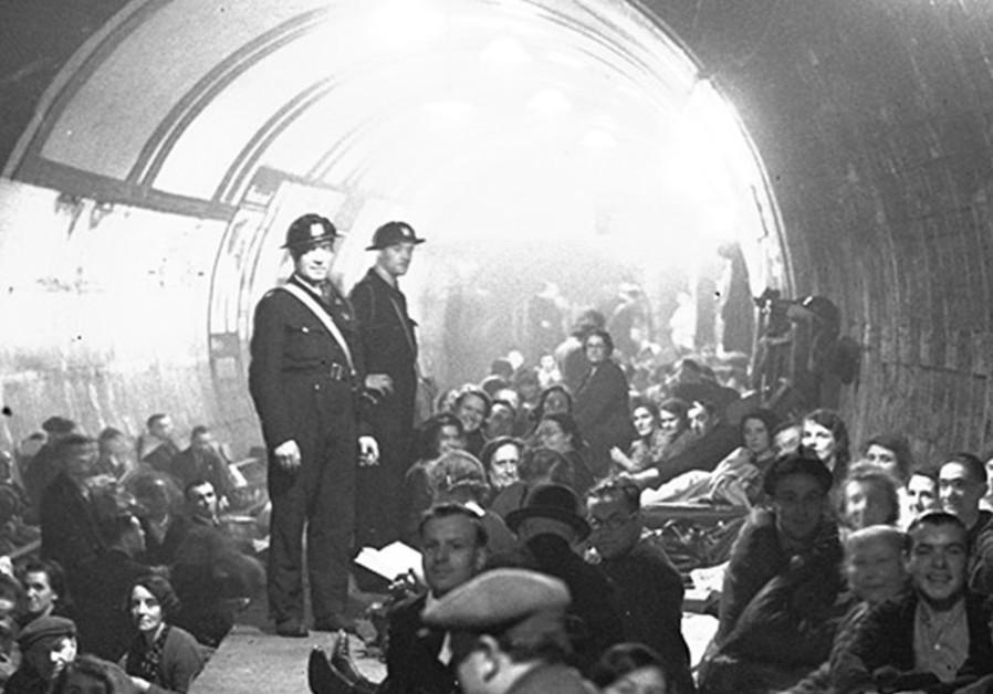LONDONERS SHELTER underground during the blitz
